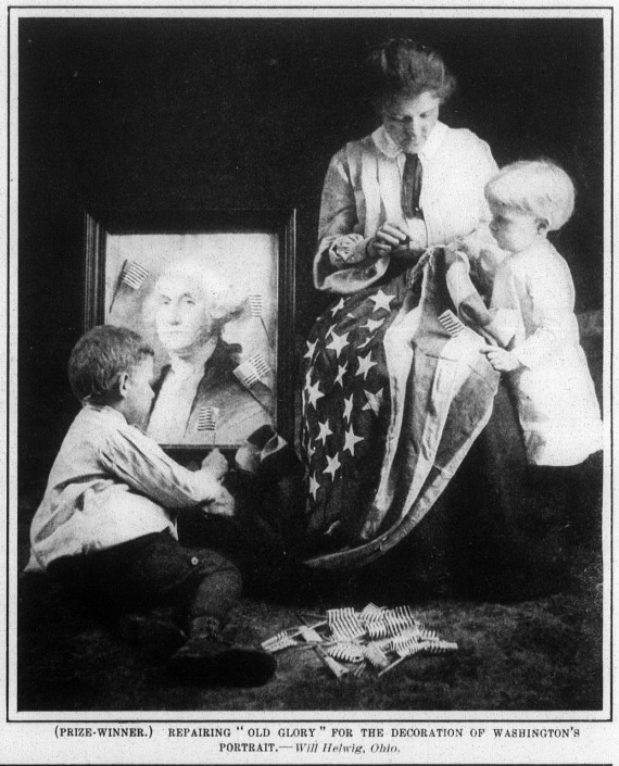 """(PRIZE-WINNER.) REPAIRING """"OLD GLORY"""" FOR THE DECORATION OF WASHINGTON 'S PORTRAIT.— Will Helwig, Ohio ."""